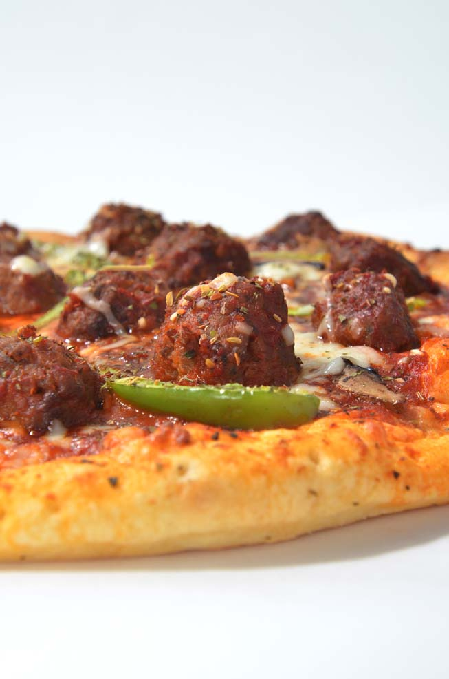 horizontal meatball pizza