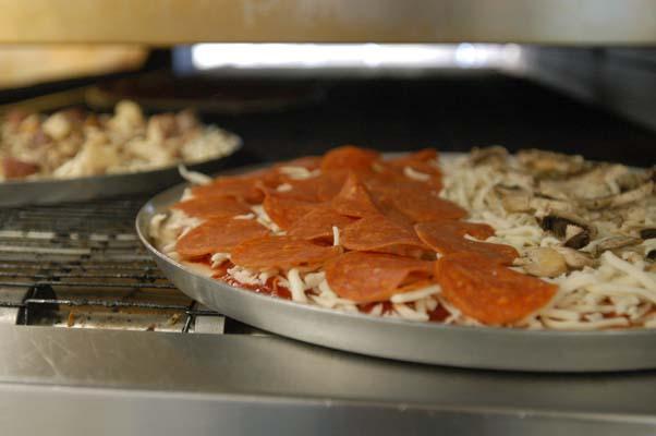 pizza in conveyor oven