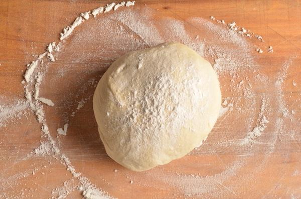 dough ball on wood peel