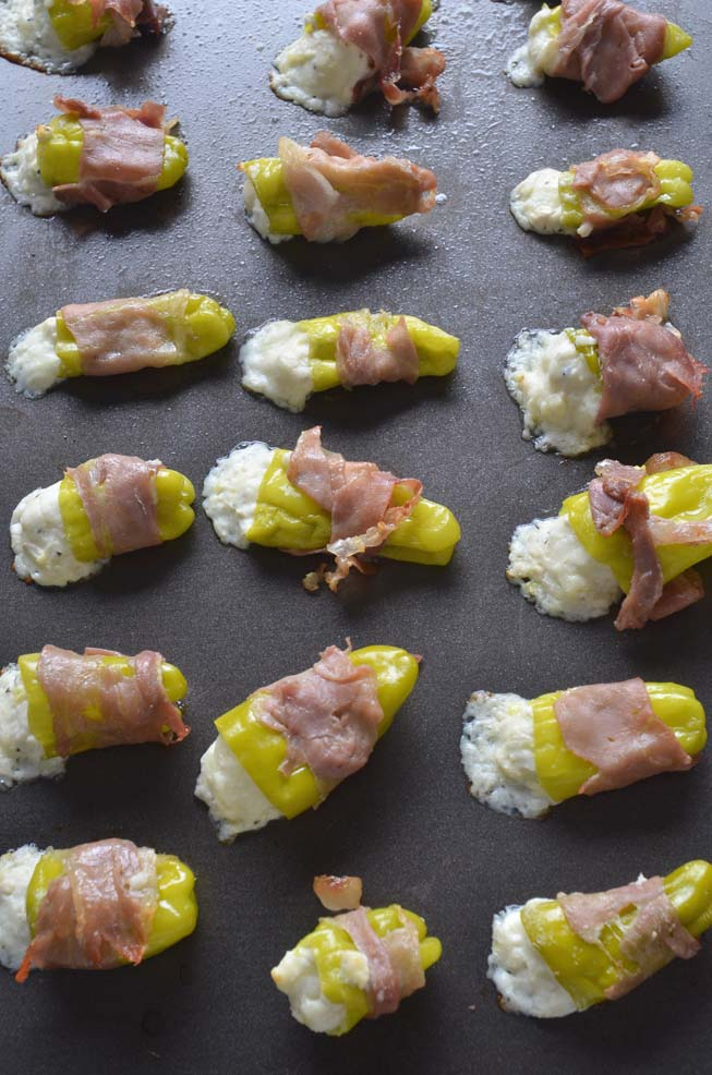 Pepperoncini Poppers stuffed with feta, cream cheese, mozzarella and wrapped in prosciutto